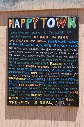HAPPYTOWN POEM NAILED TO BUILDING